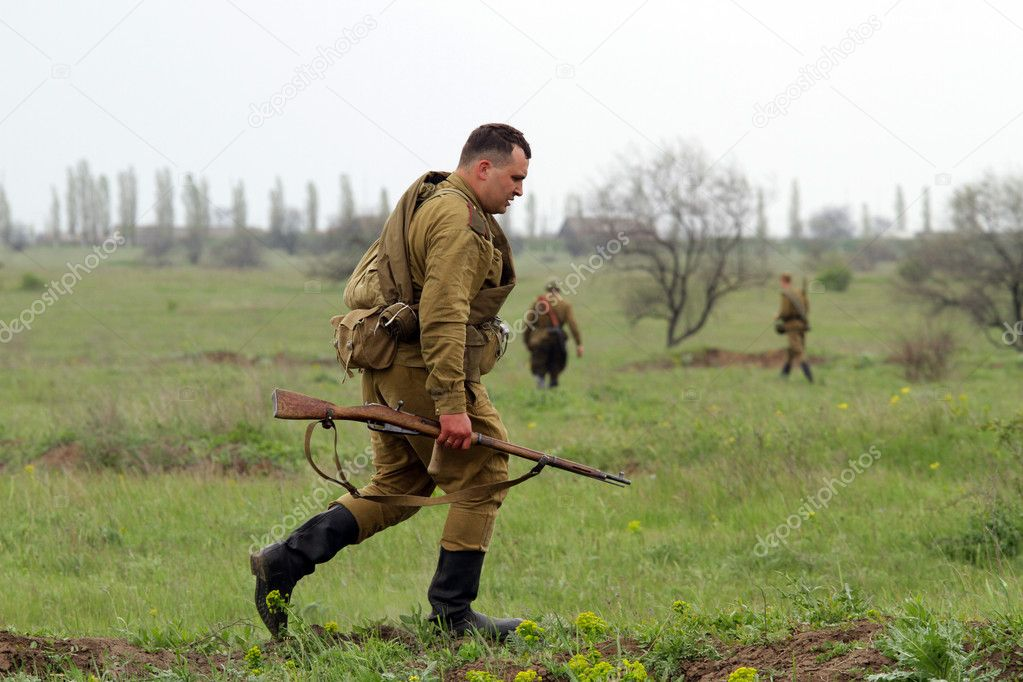 Odessa ,UKRAINE. May 8, 2011. German soldiers of WW2 at the combat. Military history club. Historical military reenacting. Demonstration for public historical r  Stock Photo #9124081