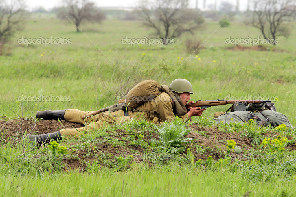 Odessa ,UKRAINE. May 8, 2011. German soldiers of WW2 at the combat. Military history club. Historical military reenacting. Demonstration for public historical r  Stock Photo #9124082