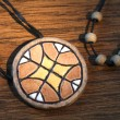 Ethnic handmade clay amulet - Stock Photo