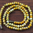 Stock Photo: Yellow plastic beads