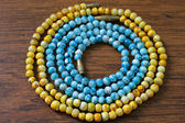 Yellow and blue plastic beads — Stock Photo
