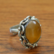 Ring with a yellow stone - Stock Photo