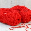 Two red balls (clews) of yarn and knitting hook — Stock Photo #9993331