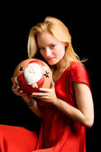 Blond girl with christmas ball — Stock Photo