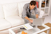 Young man working with notebook — Stock Photo