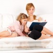 Mother reading a book — Stock Photo #9161249