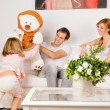 Happy Family playing at home — Stockfoto