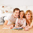Happy family at home having fun — Stockfoto