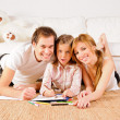 Stock Photo: Happy family at home having fun
