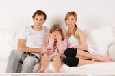 Scared daughter watching tv — Stock Photo