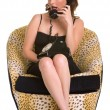 Brunette sitting and talking on a old phone in yellow shoes — Stock fotografie