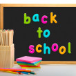 Box of coloured pencils. Back to school blackboard — Stock Photo