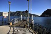 Lago de lugano y el muelle en suiza — Foto de Stock