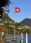 Lugano Lake Swiss flag in Switzerland — Stock Photo