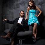 Fashion style photo of sexy couple — Stock Photo