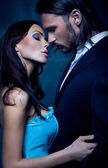 Fashion style photo of sexy couple — Stock Photo