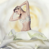 Beautiful blond woman in a rose dress on white — Foto Stock