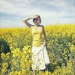 Young business woman relaxing on golden meadow — Stock Photo #9193428