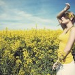 Young business woman relaxing on golden meadow — Stock Photo
