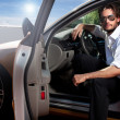 Portrait of business man inside the car — Stock Photo #9195550