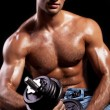 Fitness - powerful muscular man lifting weights - Stock Photo