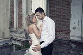 Romantic photo of a kissing couple — Stock Photo