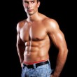 Young muscular man isolated on black background — Stock Photo #9247891