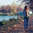 Young slim woman walking in the park — Stok fotoğraf