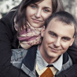 Portrait of young couple in autumn scenery — Photo