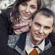 Portrait of young couple in autumn scenery — Stockfoto
