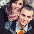 Portrait of young couple in autumn scenery — Foto de Stock
