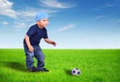 Kid playing with the ball — Stock Photo