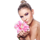 Cute woman with flower — Stock Photo