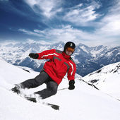 Young skier in high mountains — Stok fotoğraf