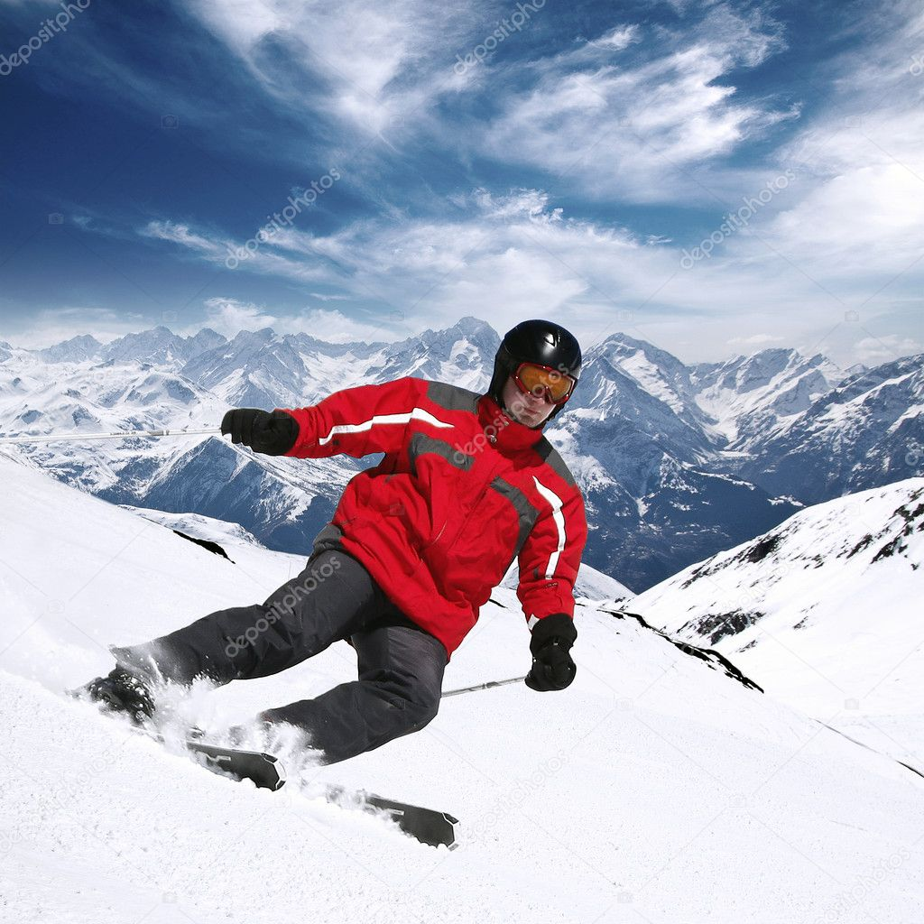 Young skier in high mountains in red — Stock Photo #10249983