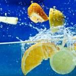 Fresh fruit in water — Stock Photo