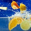 Stock Photo: Fresh fruit in water