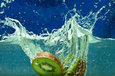 Fresh fruit kiwi in water — Stock Photo