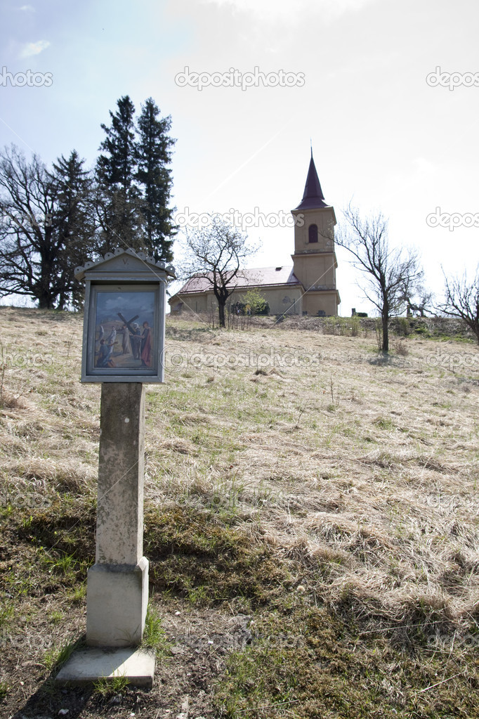 Stations of the cross with church in background — Stock Photo #10256157