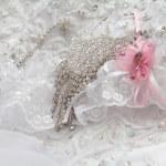 Постер, плакат: Decorating with rhinestones on the wedding dress