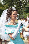 Boom brides.The girl in the dress of the bride speaks into the microphone. — Stock Photo