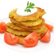 Stock Photo: Potato pancakes with slices of tomato on plate