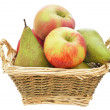 Apples and pears in a straw basket — Stock Photo