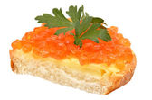 Sandwich with red caviar and parsley — Stock Photo