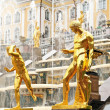 Royalty-Free Stock Photo: Peterhof, Russia - golden statues of fountain