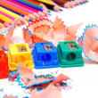 Sharpeners and pencils on a white background. - Stock Photo