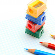 Sharpeners and pencils on white background. — Stock Photo #9147864