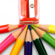 Sharpener and pencils on a white background. — Stock Photo