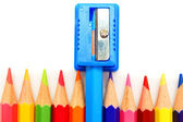 Sharpener and pencils on a white background. — Stok fotoğraf