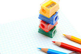 Sharpeners and pencils on a white background. — Стоковое фото